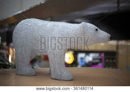 Toy Polar Bear. Figurine For Interior Decoration. The Extremely Arctic Sea Dweller. An Airy Image Ma