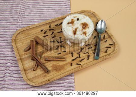 Traditional Bowl Of Hominy (canjica) On A Wooden Tray, Typical Brazilian Food At The June Festivals