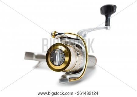 Inertialess new fishing reel isolated on white