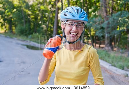 Laughing Biker Woman Outdoors In Summer Forest