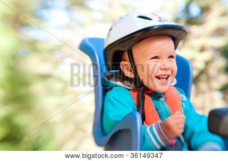Little Boy In Bike Child Seat Happy Laughing