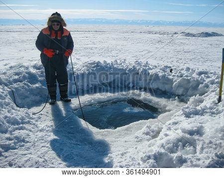 Lake Baikal, Russia - March 12, 2020: Rescue Divers Conduct Training Camps On Lake Baikal. Divers In