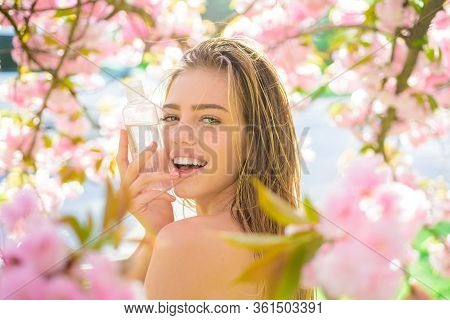 Micellar Water. Cosmetics. Makeup Remover. Healthy Skin. Nature Beauty. Woman With Bottle Of Micella