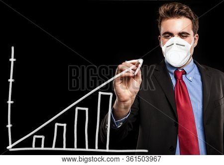 Masked businessman drawing a positive chart, coronavirus business concept opportunity