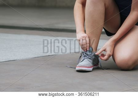 Sport Sneakers Footwear Young Woman Knelt Down Do Up Shoelaces. Ready Running Shoes In Sport Exercis