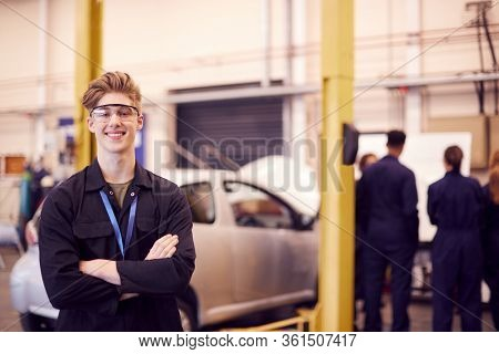 Portrait Of Male Student Wearing Safety Glasses Studying For Auto Mechanic Apprenticeship At College