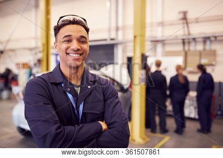 Portrait Of Male Student With Safety Glasses Studying For Auto Mechanic Apprenticeship At College
