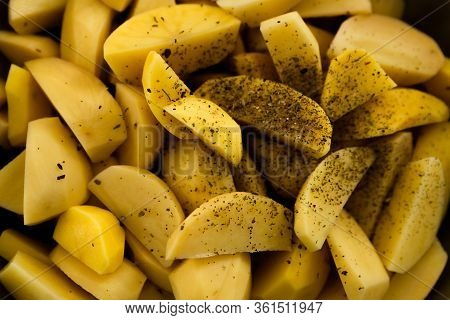 Raw Potatoes Chopped Into Small Pieces,baked Potato,chopped Potato Background,yellow Potato Texture,