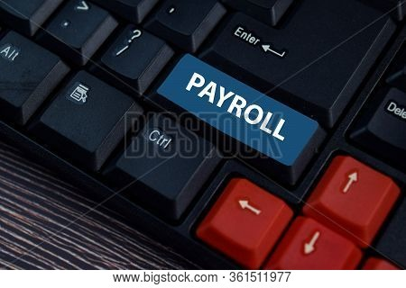 Payroll Write On Keyboard Isolated On Laptop Background