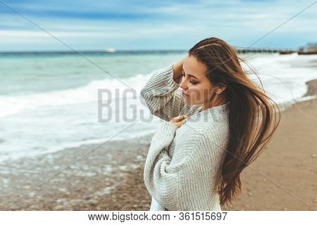 Side View Portrait Of A Woman Relaxing Breathing Fresh Air On The Beach. Half Length Portrait Of You