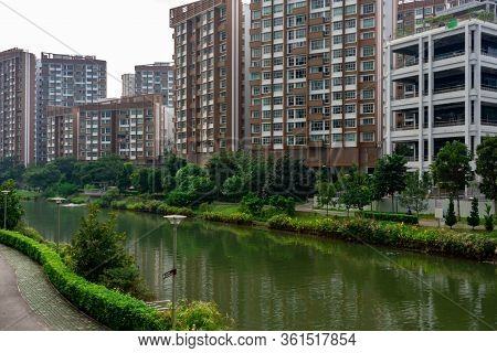 Housing Development Board Or Hdb Houses With Man Made Lake. Residential Houses With Nature Environme