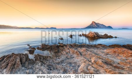 Fantastic Sunset Time Over Azure Water With Rocks Near Beach Porto Taverna. Location: Loiri Porto Sa