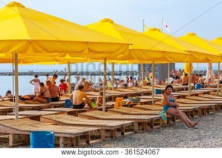Anapa, Russia - July 26, 2017: Malaya Bay In Anapa Resort. People Rest On Stony Beach Of Black Sea B