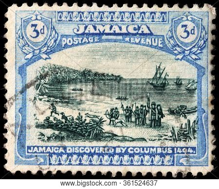 Luga, Russia - April 10, 2020: A Stamp Printed By Jamaica Shows Christopher Columbus Landing In Jama