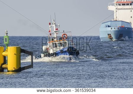 Pilot Boat And Merchant Vessel - Shipping To The Port On The Waterway