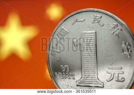 Chinese Money. 1 Yuan Coin On The Background Of The Flag Of The China Prc Close-up. Economy, Nationa