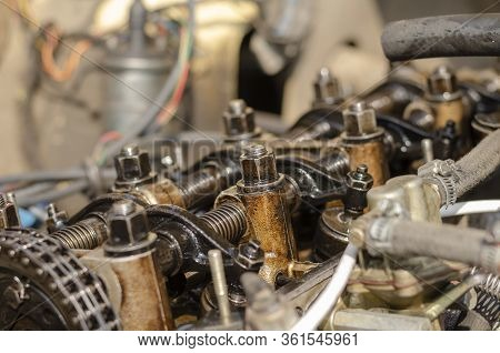 The Engine Compartment Of A Car Close-up. Detailed Shot Of A Carburetor Engine Without Valve Cover.