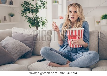 Photo Of Beautiful Crazy Terrified Barefoot Lady Sitting Comfy Couch Eat Popcorn Legs Crossed Watch