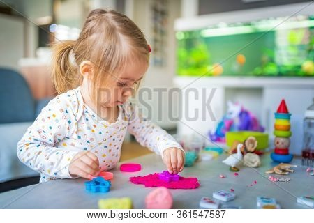 Happy Little Child, Adorable Creative 2 Year Old Girl Playing With Dough Plasticine, Colorful Modeli