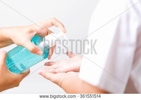Closeup Asian Mother Applying Bottle Pump Dispenser Sanitizer Alcohol Gel Cleaning Washing Hands Lit