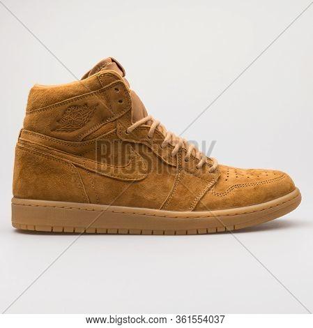 Vienna, Austria - August 24, 2017: Nike Air Jordan 1 Retro High Og Golden Harvest Khaki Sneaker On W