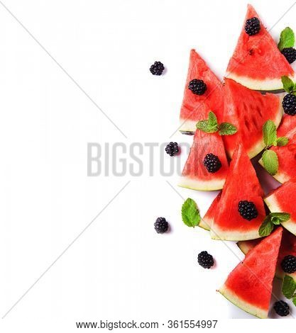 Watermelon slices and mint leaves on white backgroung. ? healthy vegetarian food
