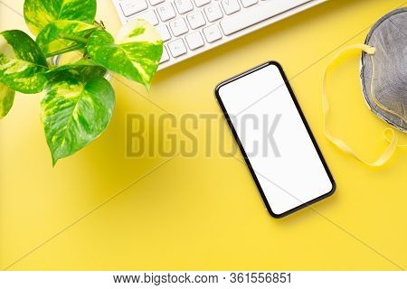 Mockup Blank Screen Mobile Phone For Coronavirus Covid19 News With Facial Masks On Yellow Office Wor