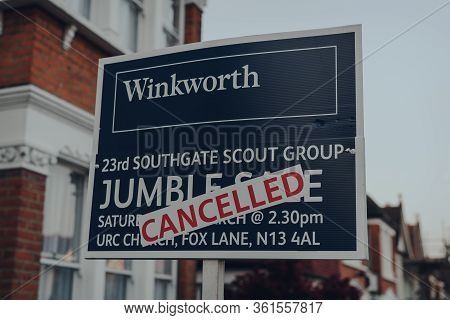 London, Uk - April 12, 2020: Cancelled Jumble Sale Sign By Winkworth Outside A House In Palmers Gree