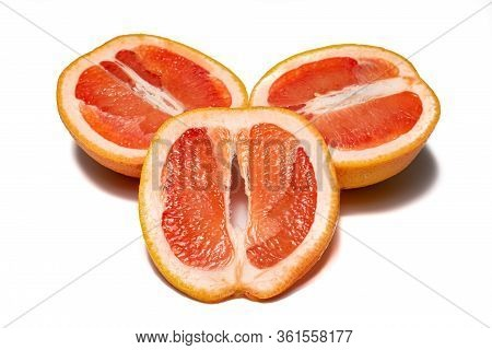 Grapefruits On White Background. Pieces Of Grapefruits And Half Grapefruits, With Little Shadow. Gro