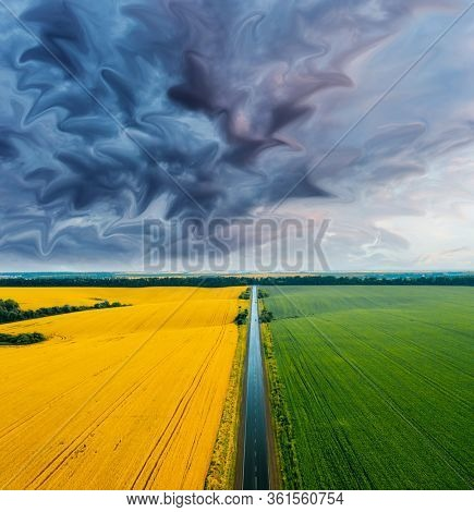 Aerial top view of rural road passing through agricultural land and cultivated fields. Location place of Ukraine, Europe. Drone photography. Artistic style photo. Discover the beauty of world.