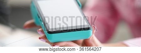 Female Hand With Manicure Holds Bank Mobile Device. Conclude An Acquiring Agreement Directly With Ba