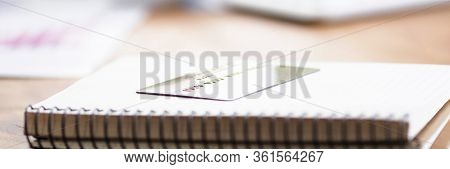 Table In Bank Notepad With Spring And Credit Card. Transfer Cash To Bank Account. Analysis Expenses