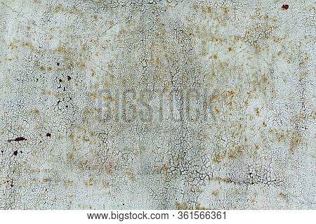 Old Cracked White Coat Of Paint Background With Leaky Rust.