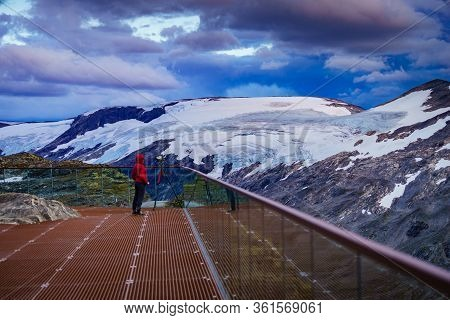 Female Tourist With Camera On Tripod Taking Travel Picture, Enjoying Mountains Landscape From Dalsni