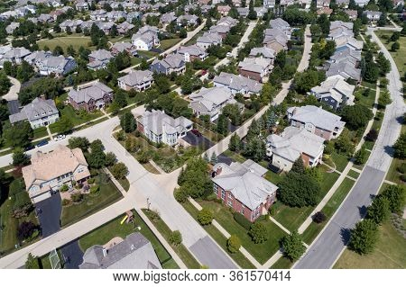 Aerial view of a tree-lined neighborhood in a Chicago suburban city in summer.
