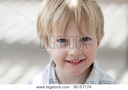 Boy Smiling At Viewer