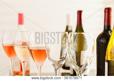 Wine Tasting Set In The Light Airy Environment. Custom Wine Tasting Concept. Glasses Of Wine And Bot