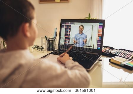 Distance Learning Online Education. A Schoolboy Boy Studies At Home And Does School Homework. A Home