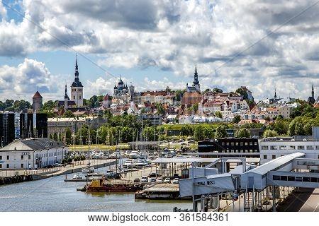 Europe, Tallinn, May, 2014 - Sea Port Berth Cruise Ships On The Background Of The Oldtown Of Tallinn
