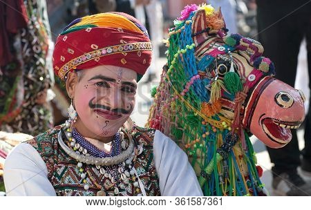 Bikaner, India - January 11, 2020: Kachhi Ghodi Dancer With Horse Costume Poses For Photo During Cam