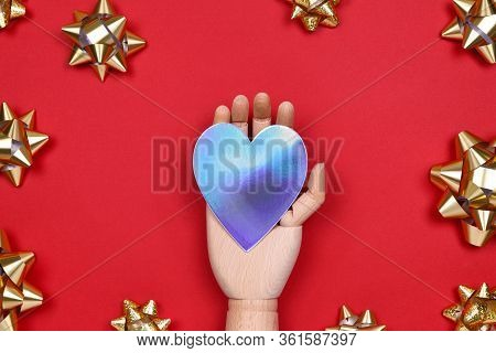 Futuristic Image With A Robot Hand Holding Silver Metal Holographic Heart On Red Drop With Golden St