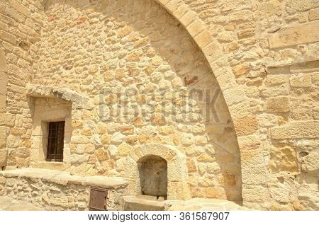 Bench On Stone Wall  In The Medieval Village Of Pals, Located In The Middle Of The Emporda Region Of