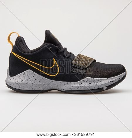Vienna, Austria - August 24, 2017: Nike Pg 1 Black And Gold Sneaker On White Background.