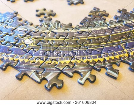 Pieces Of An Incomplete Puzzle Jigsaw On Brown Background