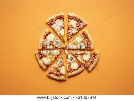 Cheese Pizza Cut In Equal Pieces On An Orange Seamless Background. Flat Lay Of Four Cheese Pizza. Qu