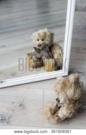 Teddy Bear Looks At His Reflection In The Mirror. Loneliness. The Concept Of Self-isolation. Stay Ho