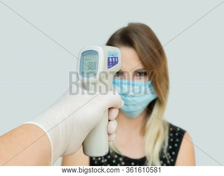 Usage Of Infrared Non-contact Forehead Thermometer Gun To Check Body Temperature For Virus Covid-19