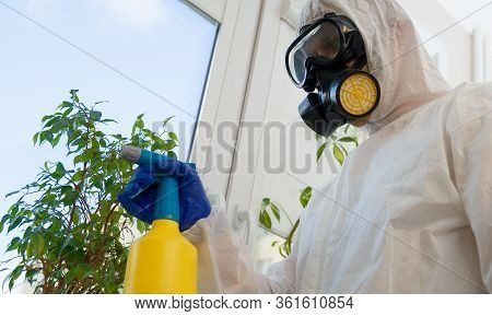 A Cleaner In Biohazard Suit Disinfecting Room.