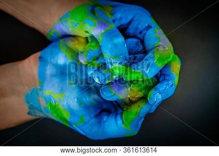 Safety of the planet earth in our hands, conceptual photo of an environmental pollution, ecological disaster, we must help our planet to stay clean