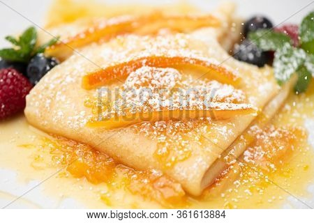 Close Up Of Crepes With Powdered Sugar And Jam
